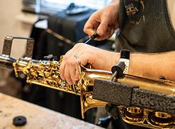 Close up of saxophone repair